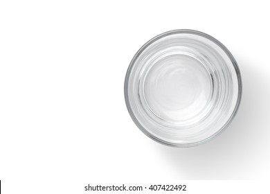 Top view of empty glass cup on white background