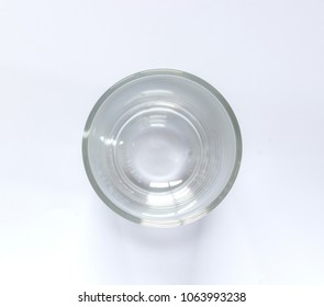 Top view of empty glass on white background. Focus glass top edge