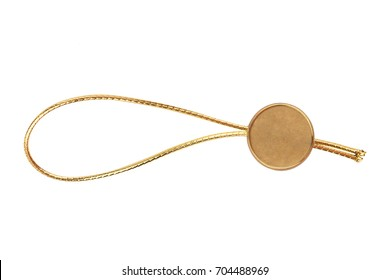 top view of empty golden metallic swing tag with gold fiber thread and copyspace isolated on white background