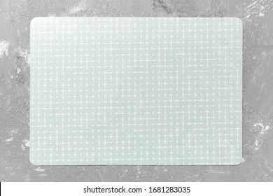 Top view of empty green table napkin for dinner on cement background with copy space.