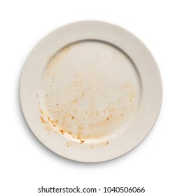 Top view of empty plate, dirty after the meal is finished isolate with clipping path, sauce smeared on a plate.