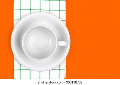 the top view of empty  red dish and towel on vibrant color background