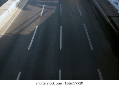 Top view of Empty road with 4 lanes.