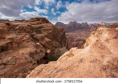 Top view of the empty valley of the city of Petra from a trekking trail with rocks under the hot sun.  Desert mountain landscape in Jordan