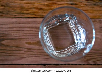 Top View Of An Empty Whiskey Glass On A Wooden Table. Healthy Living And Detox Concept. Abstinence, Alcoholism Treatment. New Year's Resolutions. Becoming A New You, Promising A Better Life.