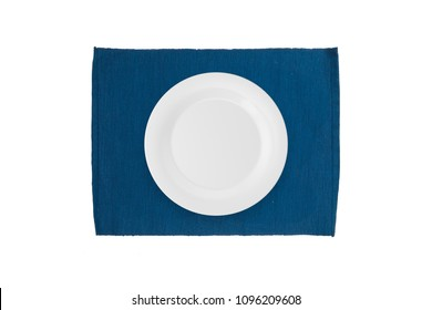 Top view of empty white plate on mat, isolated on white background.