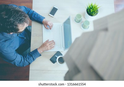 Top view of a entrepreneur working in a home office