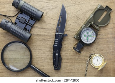 Top view of equipment for adventure on wooden background