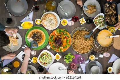 Top view of family and friends eating food on table