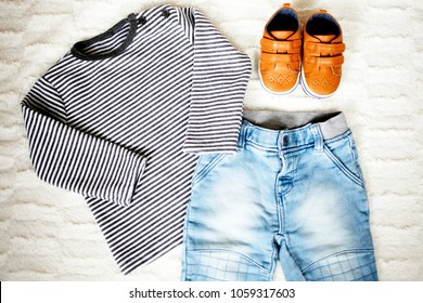 top view fashion trendy look of baby clothes and shoes, fashion concept, outfit
