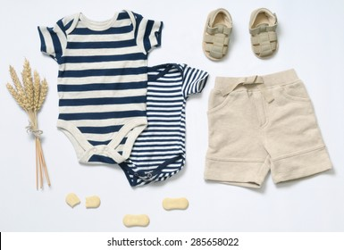 top view fashion trendy look of baby clothes and toy stuff, fashion concept