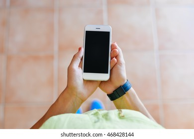 Top view of female using mobile phone, mock up screen background