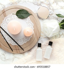 Top view with feminine elements: candles, cosmetics, rose and sticks of incense. Night routine. Lifestyle photography. Banner for blogs and social media. Flat lay