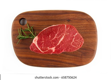 Top view of filet mignon isolated on white background.