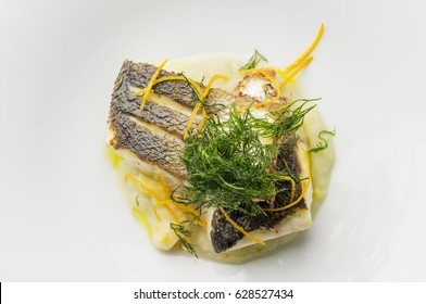 Top view of Fish dish sea bass fillet with fennel cream and citrus fruit