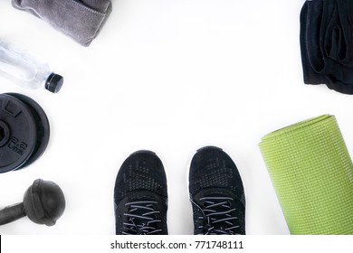 Top view of fitness accessories on white background with copy space, equipment for stretching and weight training exercises concept