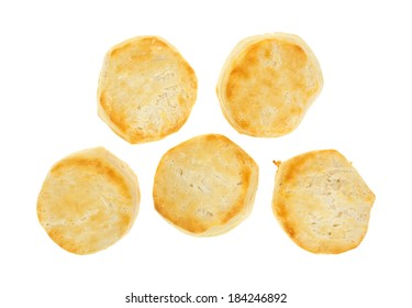 Top view of five freshly baked buttermilk biscuits on a white background.