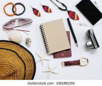 Top view / Flat lay accessoire to travel and technology with woman / lady clothing on whiteblackground closeup vintage light
