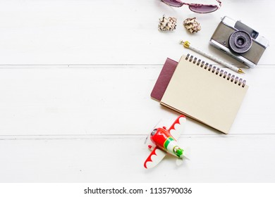 Top view / Flat lay accessoire and travel accessories copy space, white background , Passport, Thailand, plane, glasses, notebook,vintage camera