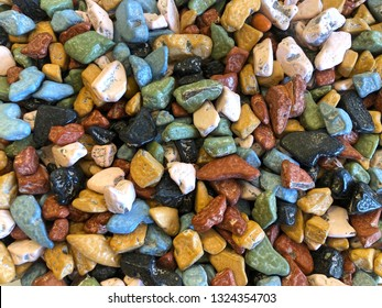 top view flat lay background of many colorful candy rocks. Flat lay top view background.