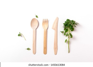 Top view and flat lay of bamboo wooden cutlery isolated on white background. Eco friendly concept