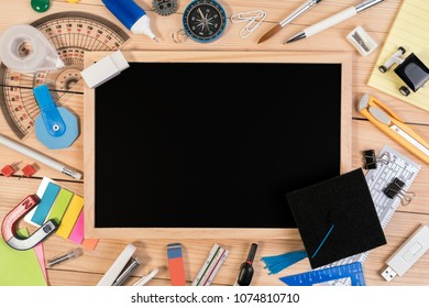 Top view flat lay. Blackboard concept for put text back to school or congratulations with school education accessories. Education background concept.