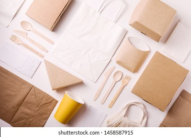Top view and flat lay concept of Eco friendly, kraft, disposable, recyclable tableware. Paper food boxes, dishes on white background