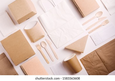 Top view and flat lay concept of Food kraft paper packaging for food delivery. Paper food boxes from eco friendly materials on white background