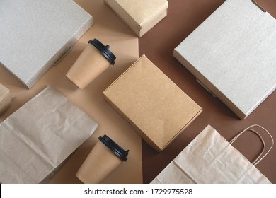 top view flat lay disposable blank delivery food packaging on a beige and brown background
