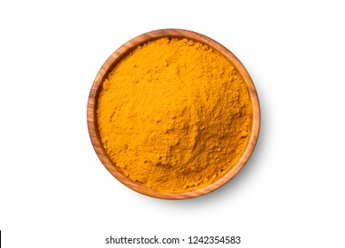 Top view (flat lay) of finely dry Turmeric (Curcuma longa Linn) powder in wooden bowl isolated on white background