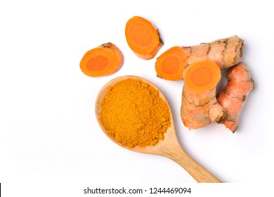 Top view (flat lay) of finely dry Turmeric (Curcuma longa Linn) in wooden spoon with rhizome (root) sliced isolated on white background.