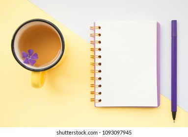 Top view flat lay picture with notepad as mockup for your design on white and yellow background.