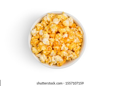 Top view (Flat lay) of popcorn coated with golden yellow caramel looks delicious isolated on white background with clipping path.