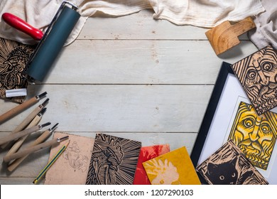 Top view flat lay of Printmaking tools for woodcut relief print arranged to form a picture frame