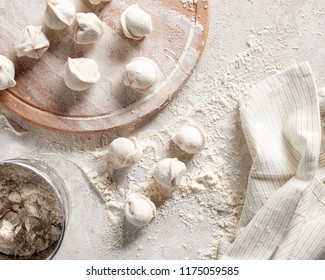 Top view flat lay raw russian dumplings with flour on table. Cooking background