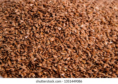 Top view, flat lay. The surface of the heap of flaxseeds. Background. Close up, macro.