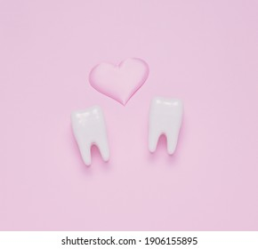 Top view flat lay Two teeth pink hearts pink pastel background. Oral care and St. Valentine's day concept.