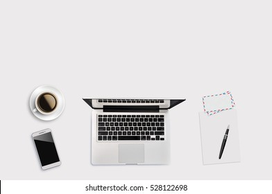 top view flat lay white table with smartphone, coffee, pen, paper and envelopes feature modern working space with large copy space area for additional text and caption. all in black and white theme.