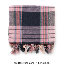 Top view of folded plaid cloth with tassels isolated on white