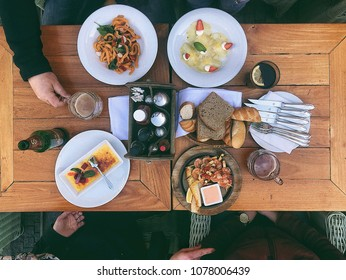 Top view food. Pasta with shrimps, fried seafood and dessert. Food photography concept. Lifestyle and rustic colors. Mobile style photo