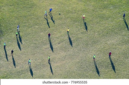 Top view of football training on grass field in winter time