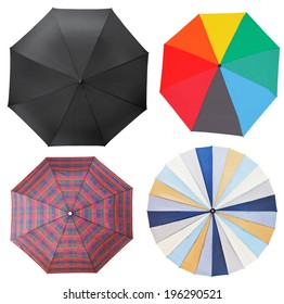top view of four different open umbrellas isolated on white background