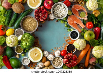 Top view frame of healthy and diet food (cereals, seeds, fish, vegetables and fruits). Healthy and diet menu of restaurant concept