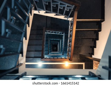 Top view, Frame square of vintage spiral staircase with light shiny in hotel