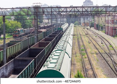Top view of a freight railroad station with trains with freight wagons of different types