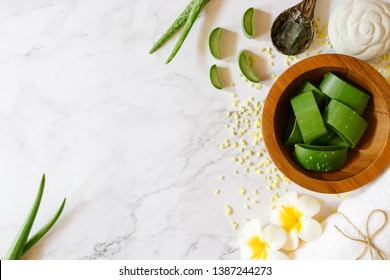 Top view of fresh aloe vera leaves in wooden bowl. spa background concept.