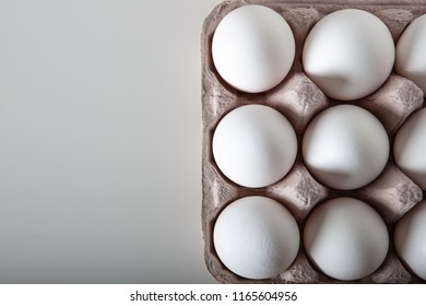 Top view of fresh eggs on paper tray. Full frame high quality image with text area