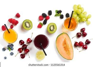 Top view of fresh juices of summer fruits and berries - raspberry, blueberry, blackberry, kiwi, melon and grape in glasses with drinking straws isolated on white background. Summer concept.