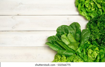 Top view of fresh Lettuce  on wooden background.