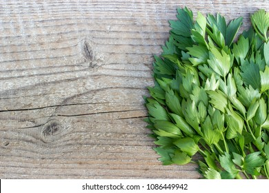 top view of fresh lovage on a wooden board
